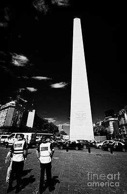 policia federal argentina federal police officers on duty talking to people in downtown Buenos Aires Art Print by Joe Fox