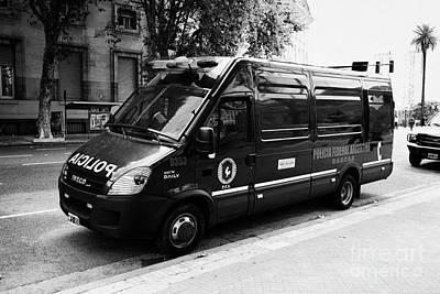 Police Van Photograph - policia federal argentina federal police riot control doucad vehicle Buenos Aires Argentina by Joe Fox