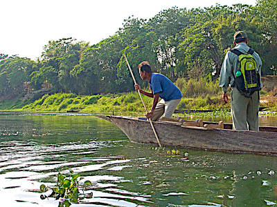 Poling A Dugout Canoe In The Rapti River In Chitwan National Park-nepal Original by Ruth Hager