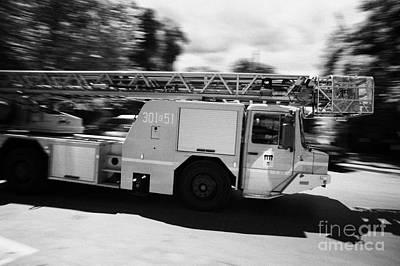 Polish Fire Brigade Fire Guard Straz Krakow Ladder Vehicle Speeding Past On Way To Fire Art Print by Joe Fox