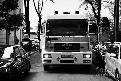 Polish City Photograph - Polish Fire Brigade Fire Guard Straz Krakow Vehicle Parked In Middle Of City Street Firefighter Attending Emergency Call Out by Joe Fox