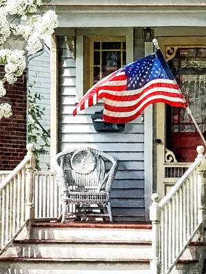 Photograph - Porch With Flag And Wicker Chair by Susan Savad