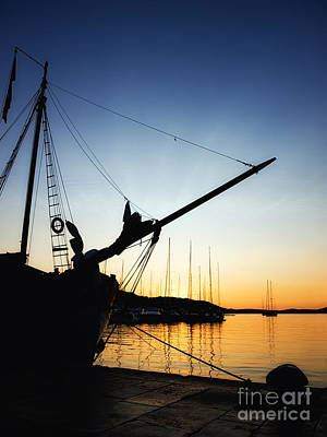 Blue Pirate Ships Landscape Photograph - Port In The Sunset by Sinisa Botas