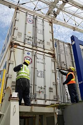 Port Workers Handling Cargo Containers Art Print by Jim West