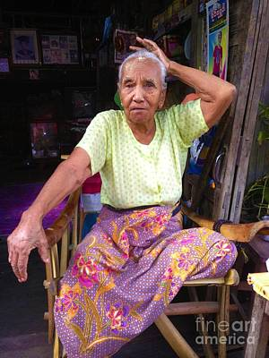 Photograph - Portrait Of Elderly Burmese Lady Sitting In Front Of Home 33rd Street Chanayethazan Mandalay Burma by Ralph A  Ledergerber-Photography
