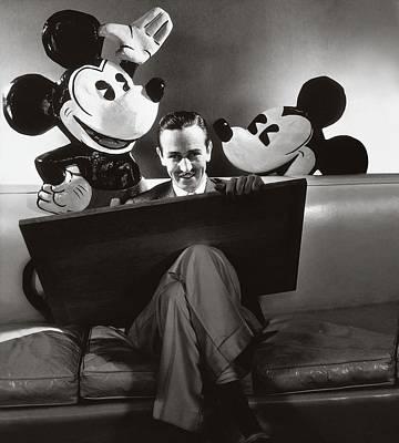 Cross Legged Photograph - Portrait Of Walt Disney Sitting With Open Cartoon by Edward Steichen