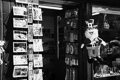 Avoca Photograph - Postcards Stickers And Soft Toy Leprechaun Hanging Outside Tourist Souvenir Shop In Avoca County Wicklow by Joe Fox