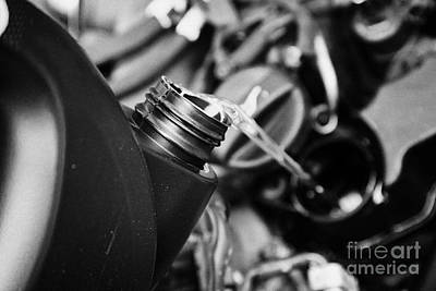 Intervals Photograph - Pouring Fresh New Oil Into Engine Filler In A Car Engine Compartment by Joe Fox