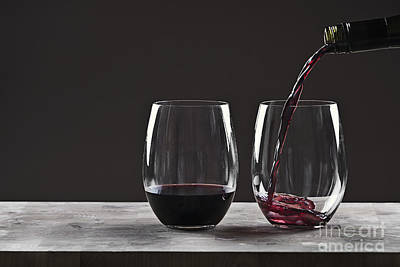 Pouring Red Wine Art Print by Justin Paget