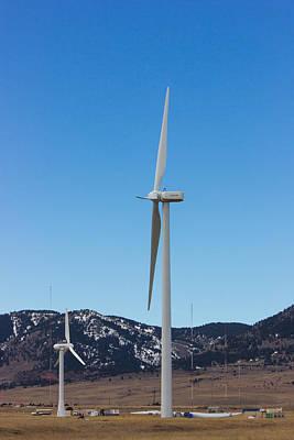 The Beach House - Power Generating Windmills Await the Breeze by Tony Hake