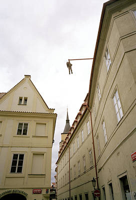 Prague's Hanging Man Print by Shaun Higson