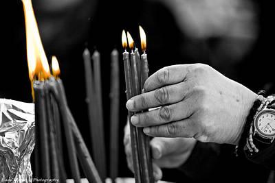 Baptizing Photograph - pilgrim light a candle Jericho by Isaac Silman