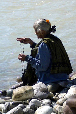 Puja Photograph - Prayer By The Ganges by Catherine Arnas