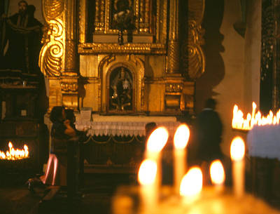 Photograph - Praying By Candlelight by Robert  Rodvik