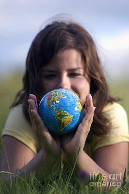 Photograph - Pretty Girl Watching Earth Globe by Michal Bednarek