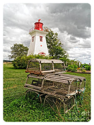 Lobster Traps Photograph - Prince Edward Island Lighthouse With Lobster Traps by Edward Fielding