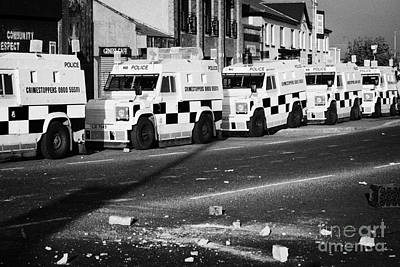 Terrorist Photograph - Psni Armoured Land Rovers And Debris On Crumlin Road At Ardoyne Shops Belfast 12th July by Joe Fox