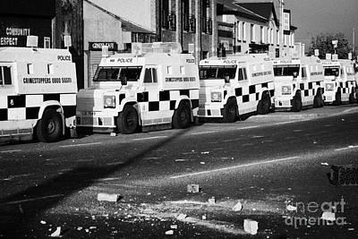 Psni Armoured Land Rovers And Debris On Crumlin Road At Ardoyne Shops Belfast 12th July Art Print by Joe Fox
