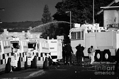 Psni Armoured Land Rovers And Water Canon On Crumlin Road At Ardoyne Shops Belfast 12th July Art Print