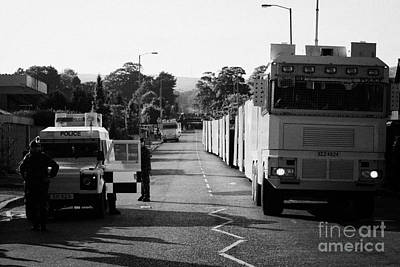 Psni Landrover And Watercannon In Wait In Preparation On Crumlin Road At Ardoyne Shops Belfast 12th  Art Print by Joe Fox