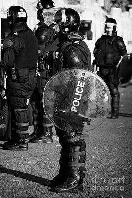 Psni Officer In Full Riot Gear With Shield On Crumlin Road At Ardoyne Shops Belfast 12th July Print by Joe Fox