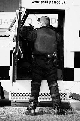 Psni Officer Puts On Protective Ruiot Gear On Crumlin Road At Ardoyne Shops Belfast 12th July Art Print