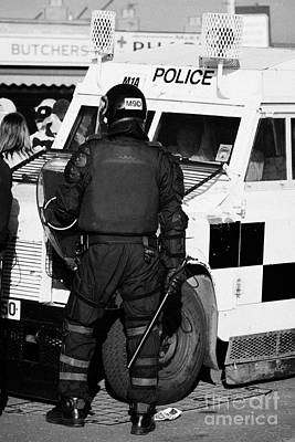 Psni Officer With Riot Gear And Baton In Front Of Land Rover On Crumlin Road At Ardoyne Shops Belfas Art Print