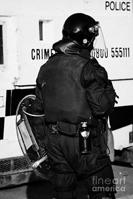 Terrorist Photograph - Psni Officer With Riot Gear On Crumlin Road At Ardoyne Shops Belfast 12th July by Joe Fox