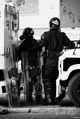 Terrorist Photograph - Psni Officers In Protective Riot Gear At Landrovers On Crumlin Road At Ardoyne Shops Belfast 12th Ju by Joe Fox