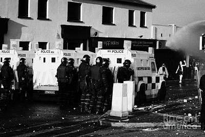 Terrorist Photograph - Psni Officers Watch Rioters Being Hit By Water Canon On Crumlin Road At Ardoyne Shops Belfast 12th J by Joe Fox
