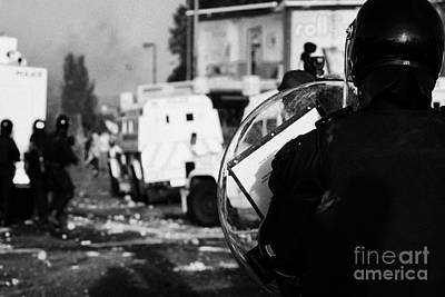 Psni Riot Officer With Baton Round Warning On Shield Watches Rioting On Crumlin Road At Ardoyne Shop Art Print