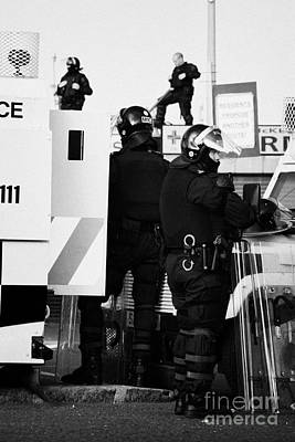 Psni Riot Squad Officers In Protective Gear And Snipers On Crumlin Road At Ardoyne Shops Belfast 12t Art Print by Joe Fox