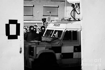 Psni Surveillance Land Rover Watches Crowd On Crumlin Road At Ardoyne Shops Belfast 12th July Art Print by Joe Fox