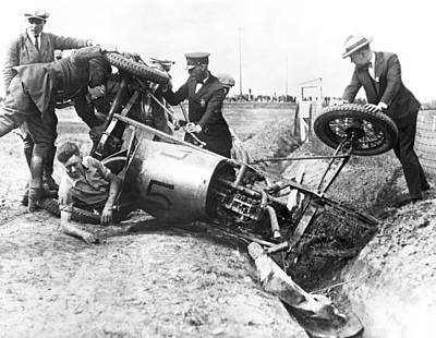 Medium Group Of People Photograph - Race Car Driver Crashes by Underwood Archives