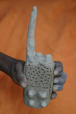 Clay Relief Photograph - Radio Made Out Of Mud Is A Popular Toy by Ton Koene