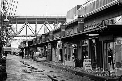 Granville Island Photograph - railspur alley home to various artisan and artists shops stores and galleries Vancouver BC Canada by Joe Fox