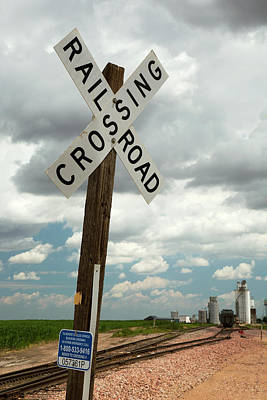 Railroad Crossing Photograph - Railway Crossing And Grain Elevators by Jim West