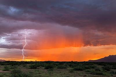 Lightning Bolts Photograph - Rain Storm At Sunset by Roger Hill