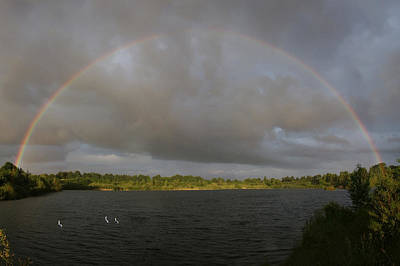 Photograph - Rainbow Over A Lake by Jay Evers