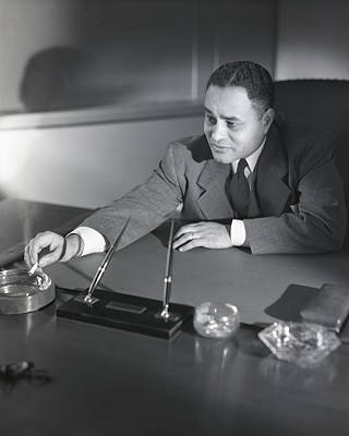 Photograph - Ralph L. Bunche Smoking by Horst P. Horst