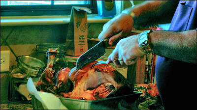 Photograph - Ralph Slices Thanksgiving Turkey 2009 by Glenn Bautista
