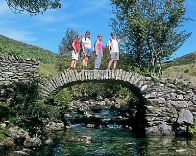 Ambleside Wall Art - Photograph - Ramblers On A Stone Bridge by Martin Bond/science Photo Library