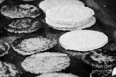 Raw And Cooked Processed Hamburgers On A Commercial Flat Grill At An Outdoor Event Art Print by Joe Fox