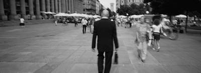 Rear View Of A Businessman Walking Art Print by Panoramic Images