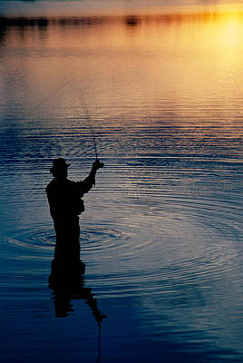 Rear View Of Fly-fisherman Silhouetted Art Print by Panoramic Images
