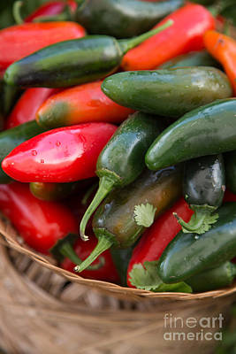 Photograph - Red And Green Chilis In Basket by Rebecca Cozart