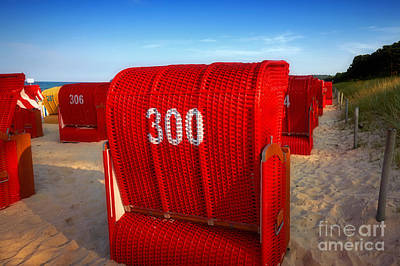 Photograph - Red Beach Chairs In The Early Evening Light by Nick  Biemans