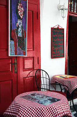 Photograph - Red Cafe Art In Mykonos by John Rizzuto