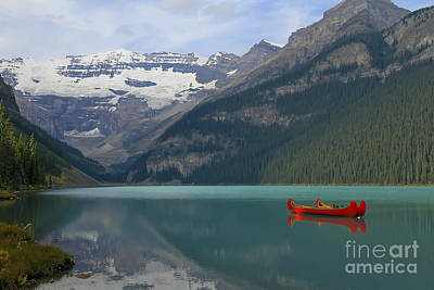 Red Canoes On Lake Louise Art Print by Teresa Zieba