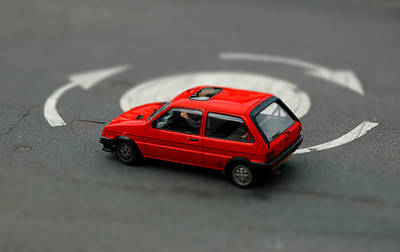 Photograph - Red Car In Roundabout. by Rob Huntley